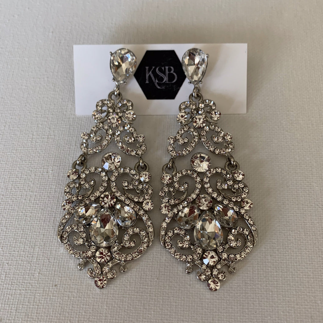 These long hanging crystal bridal earrings are all that you need to complement your beautiful bridal gown.   They are hypoallergenic, lead, nickel and cadmium free.  They contain czech crystals and AAA+ Cubic Zirconia   From top to bottom of earring is 9 cm in length