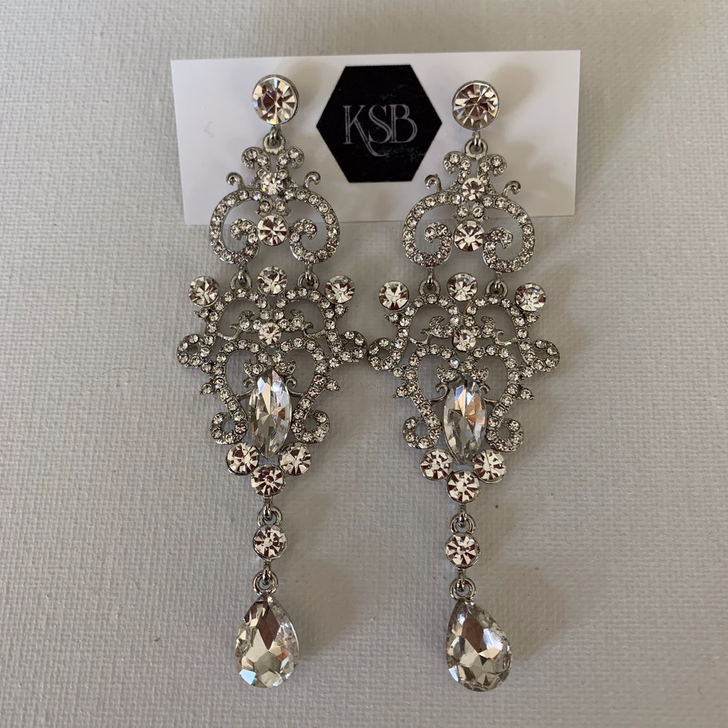 These rhodium plated crystal earrings are perfect to go with your bridal gown or that special evening dress.  They are hypoallergenic, lead, nickel and cadmium free.  They contain czech crystals and AAA+ Cubic Zirconia   From top to bottom of earring is 3 cm in length