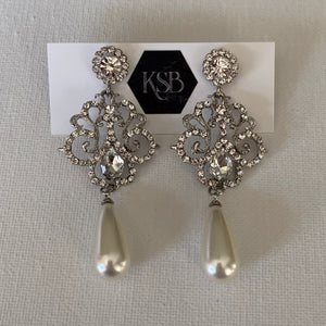 These crystal and pearl bridal earrings are all that you need to complement your beautiful bridal gown.   They are hypoallergenic, lead, nickel and cadmium free.  They contain high quality czech rhinestone and crystals  From top to bottom of earring is 7 cm in length