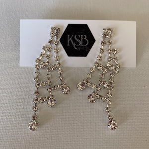 These elegant silver plated rhinestone earrings can be worn as bridal earrings or for a formal evening out.   Crystal Rhinestones  Silver Plated   Lead, nickel and cadmium free