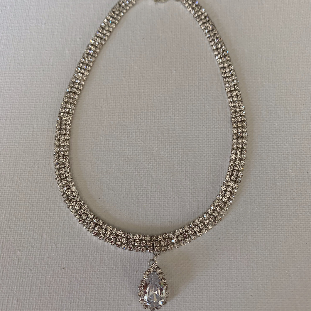 If you are going out to a party or a black tie event, this choker is the perfect accessory that will enhance your outfit. It features an amazing design and will suit any formal or casual ensemble.    It is hypoallergenic, lead and nickel free.    It has a triple row of rhinestones.   The teardrop is a AAA+ high quality cubic zirconia    The choker is 32 cm in length and has a 10 cm extender.