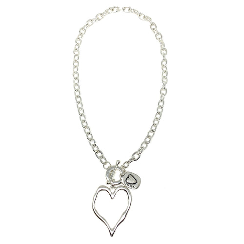 "Discover eye-catching, straight-off-the-runway inspired pieces. One statement piece, infinite possibilities…  Merx Modern is exclusively designed and handmade in Canada.  This short necklace has a silver hollowed heart with a silver love pendant   This necklace length is 20"" + toggle closure"