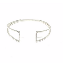 Load image into Gallery viewer, This 925 sterling silver cuff bangle is the perfect complement to any outfit. Can be worn stacked or on its own.  High quality cubic zirconia on each side of bangle.  Rhodium plated  Lead, nickel free, tarnish resistant