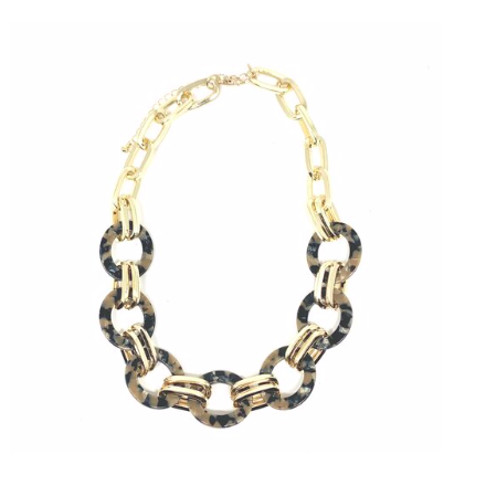 "The fashion trend for tortoise jewelry continues and is very popular this year. This short necklace is a great option to pair up with a simple black dress or goes great with a v neck shirt.  This necklace is 16"" + 3"" extender"