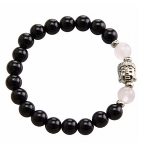 Stretchable bracelet with two rose quartz beads surrounding a Buddha charm. Accented with black onyx beads.As a healing stone, black onyx is thought to increase regeneration, happiness, intuition and instincts.  Includes:  1 bracelet, 18 cm in circumference with stretch cord, 9 mm beads