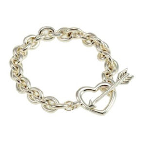 "This trendy chain bracelet is great to wear on its own or with your other favourites.  This light gold chain bracelet has a heart and arrow toggle clasp   Lead and nickel free  Hypoallergenic  Size: 8"" in length"