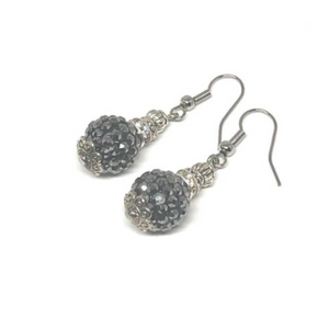These black glitter ball earrings are very elegant. The finishings on each earring are white gold plated.  They are hypoallergenic, lead and nickel free and tarnish resistant  Length: 4cm in length