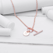 "Load image into Gallery viewer, BEST SELLER!  LAST ONE AVAILABLE!!  24K Rose Gold Plated brass chain (Short 18"" length)  24K Rose Gold Plated brass B&U charm  T-Closure on front  A portion of proceeds donated to help Veterans  This B&U Charm necklace is small, stackable and perfect for almost any outfit"