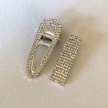 Load image into Gallery viewer, Style your hair with these beautiful duo rhinestone clips. It is the perfect accessory to any outfit! Both clips are with clear rhinestones. Can be worn each as a single clip or together. You can also mix and match with another favourite clip of yours!  Two pieces