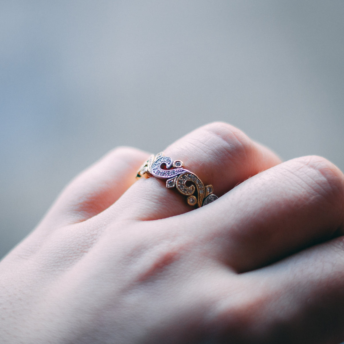 Lifestyle picture of the two coloured diamond band on a model.