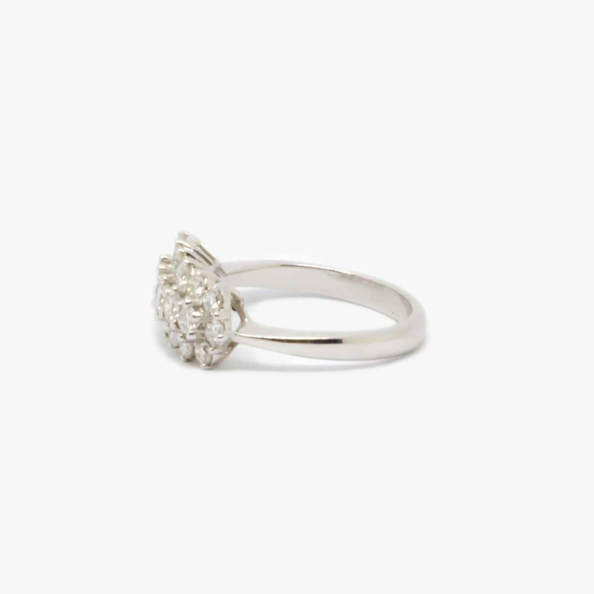 Ring in white gold with nineteen diamonds in total along three rows left side view.