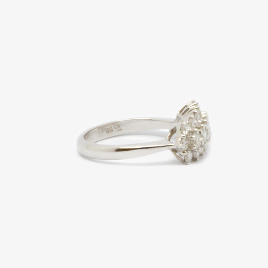 Ring in in white gold with nineteen diamonds in total along three rows right side view.