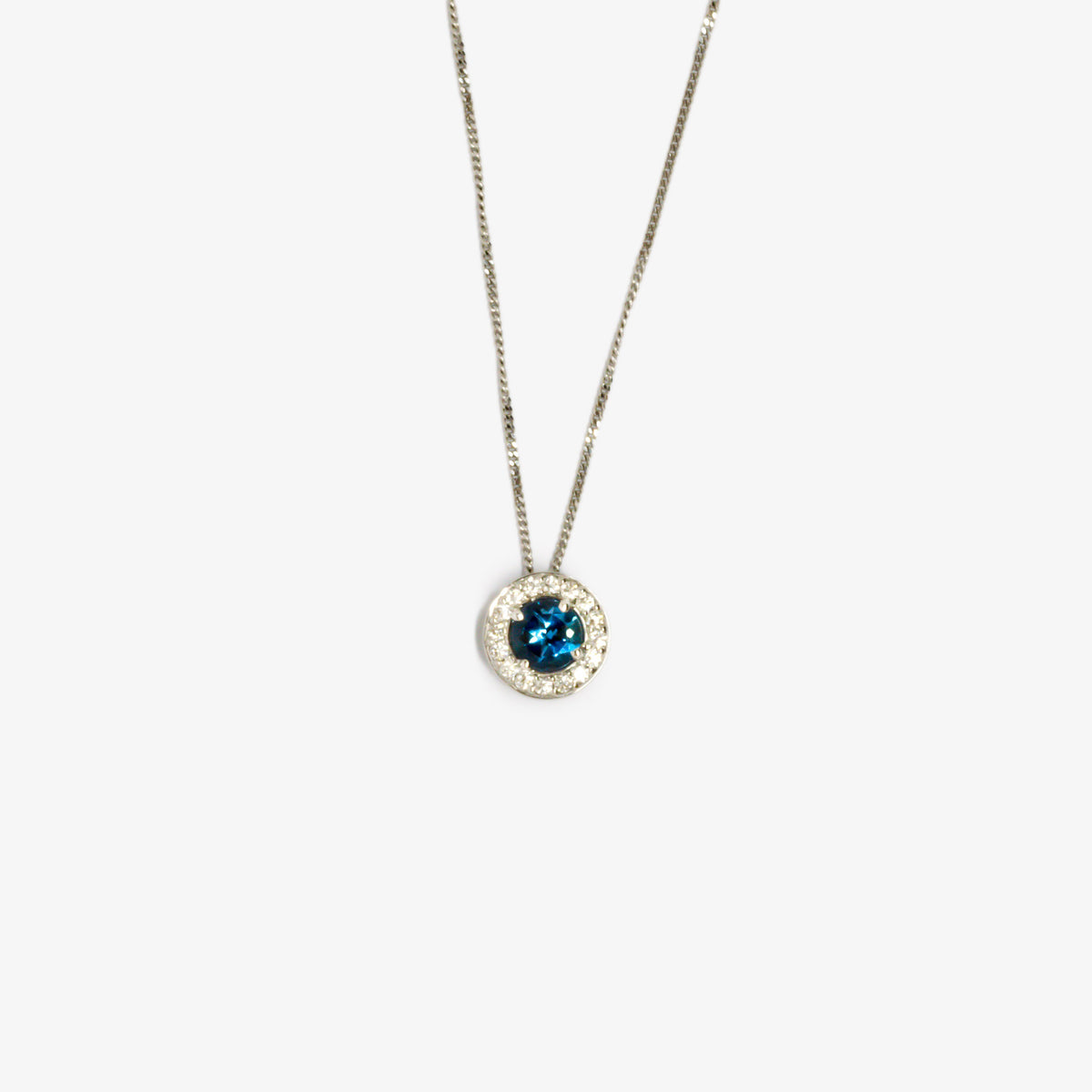 Blue aquamarine and diamond cluster pendant necklace in white gold close-up