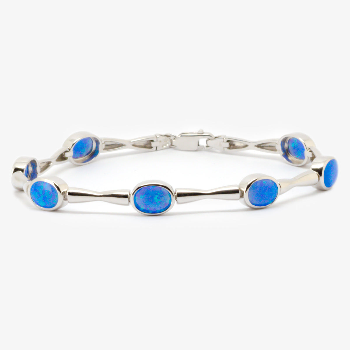 Picture of a bracelet in silver with seven blue created opals front view.