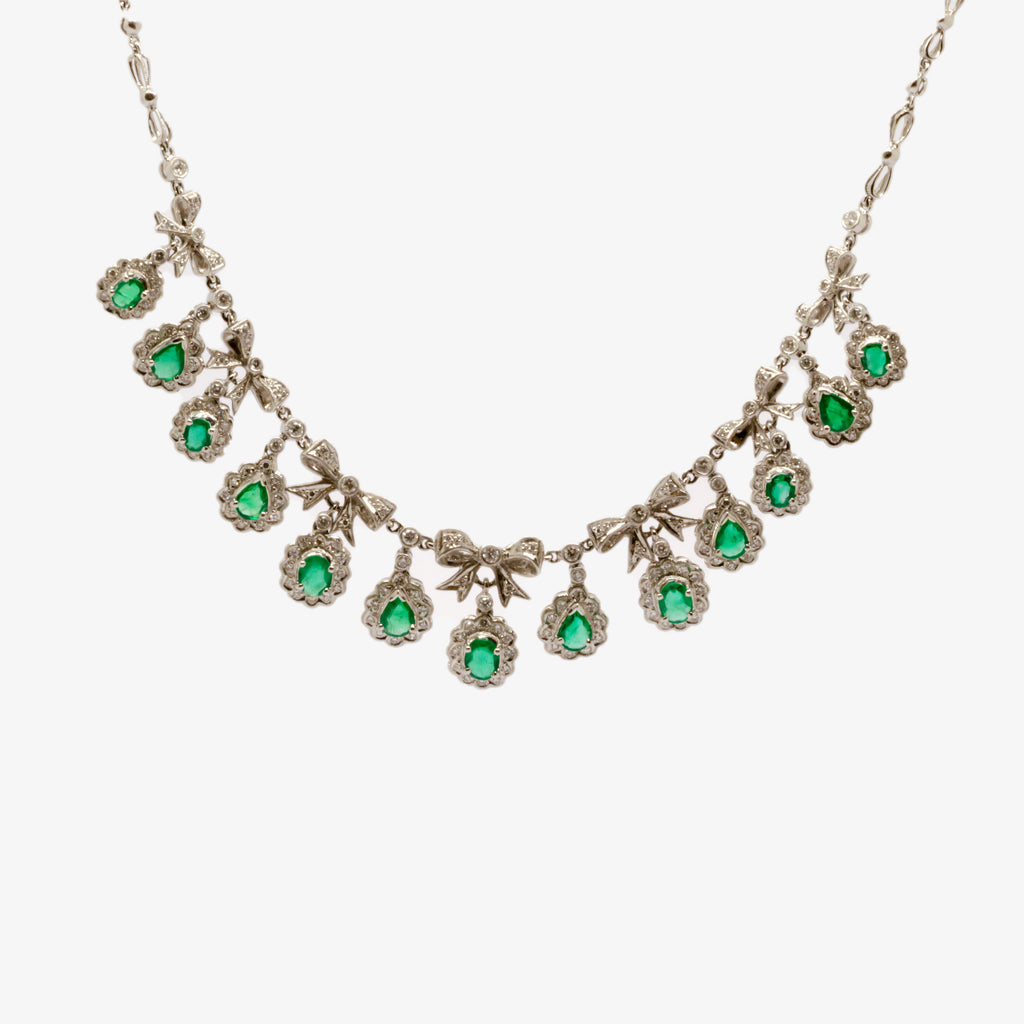 Jordans Jewellers pre-owned 18ct white gold emerald and diamond bow necklace