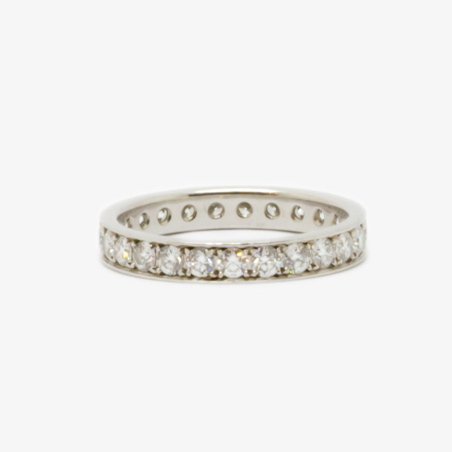 Ring in platinum with diamonds around the band in a full eternity style.
