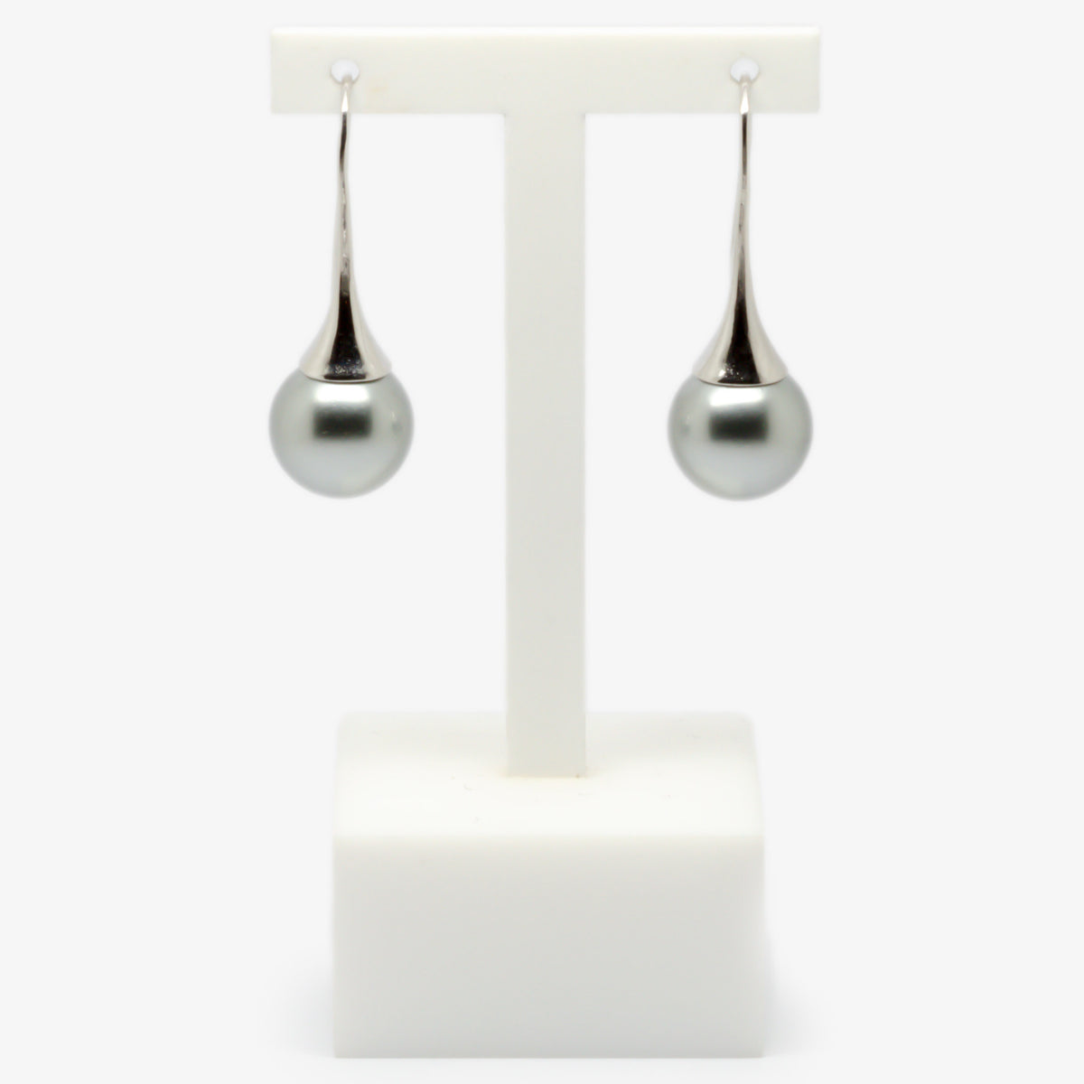 Grey colour shell pearl drop earrings on a earrings stand front view