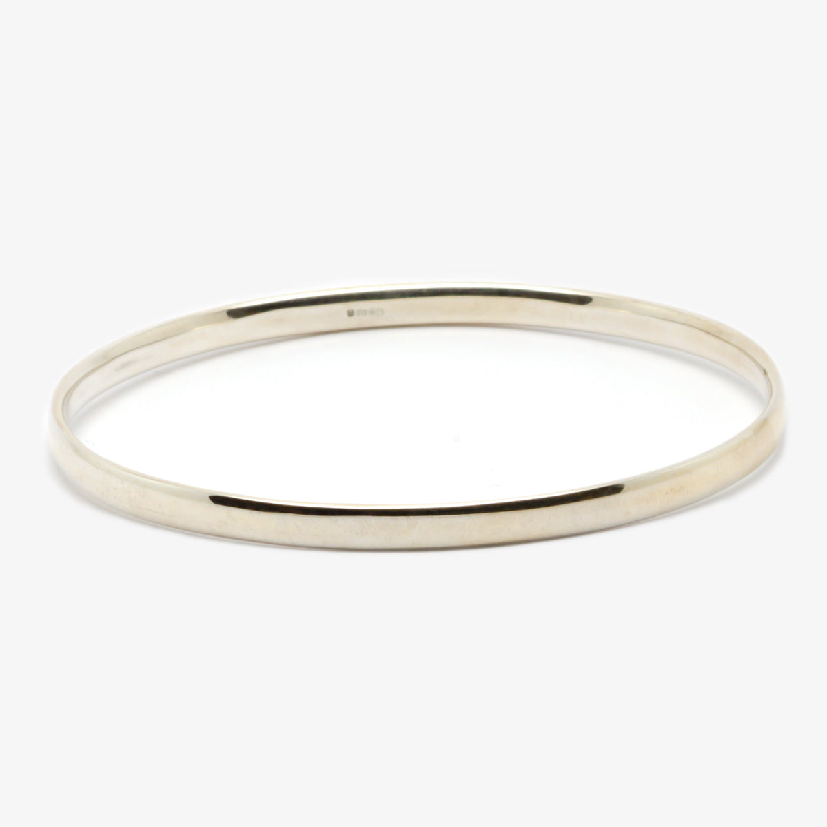 Bangle in silver in an oval shape front view.