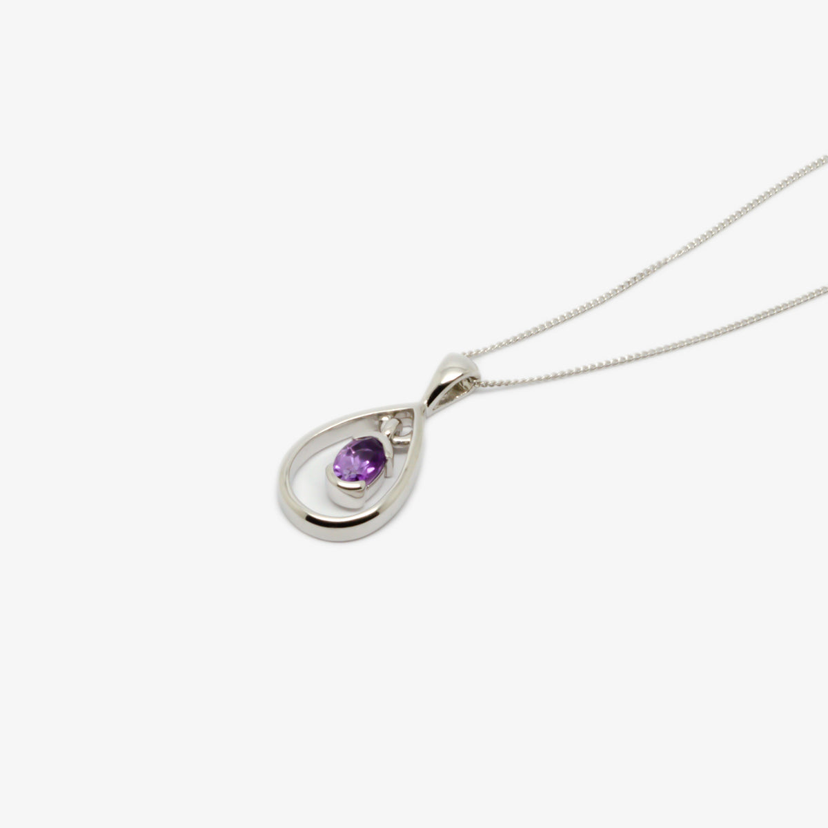 Close-up side view picture of the amethyst and silver pendant necklace.