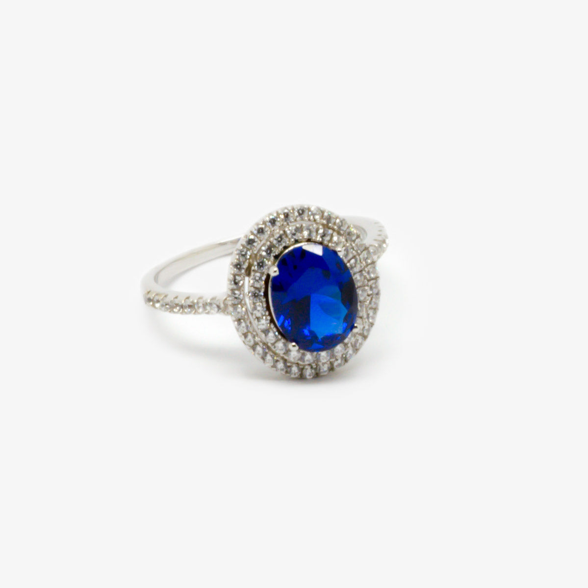 Front view of the double halo blue crystal oval ring.