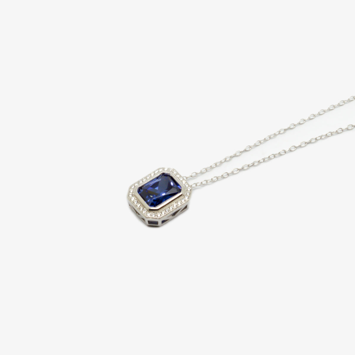 Close up and from the side picture of the dark blue cubic zirconia pendant necklace.