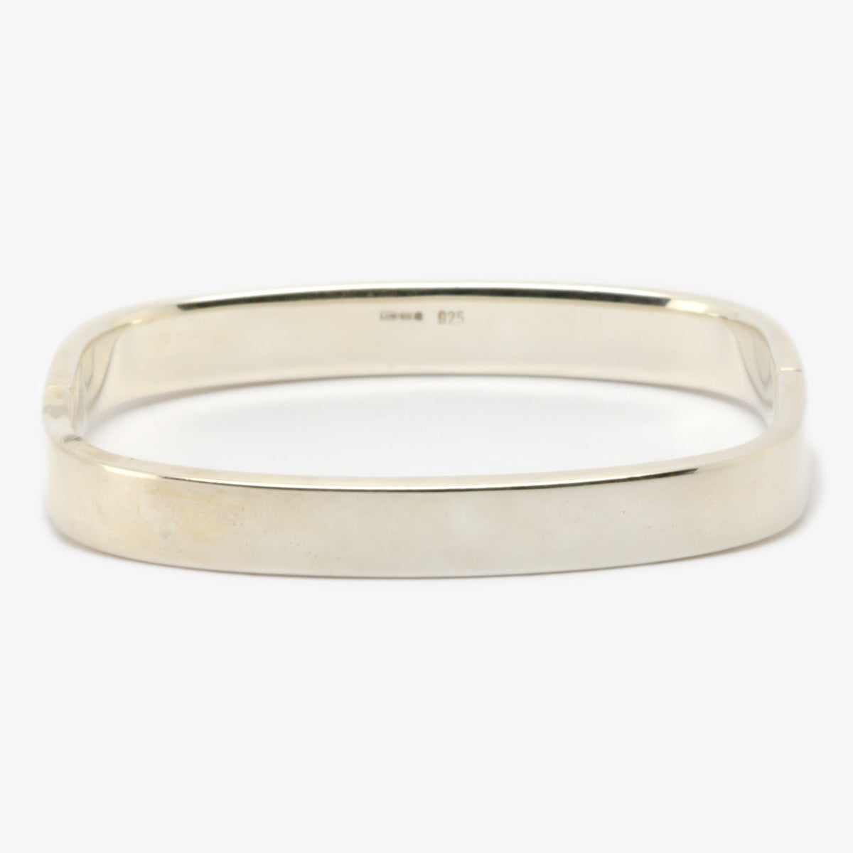 Picture of a bangle in silver shaped like a 'TV' and is hinged on the side making it easy to put on and take off front view.