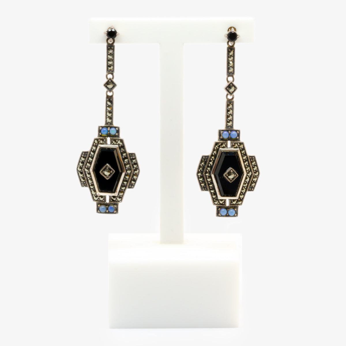 Picture of earrings in silver with marcasite, black onyx with four opals and a long drop in an art deco style front view.