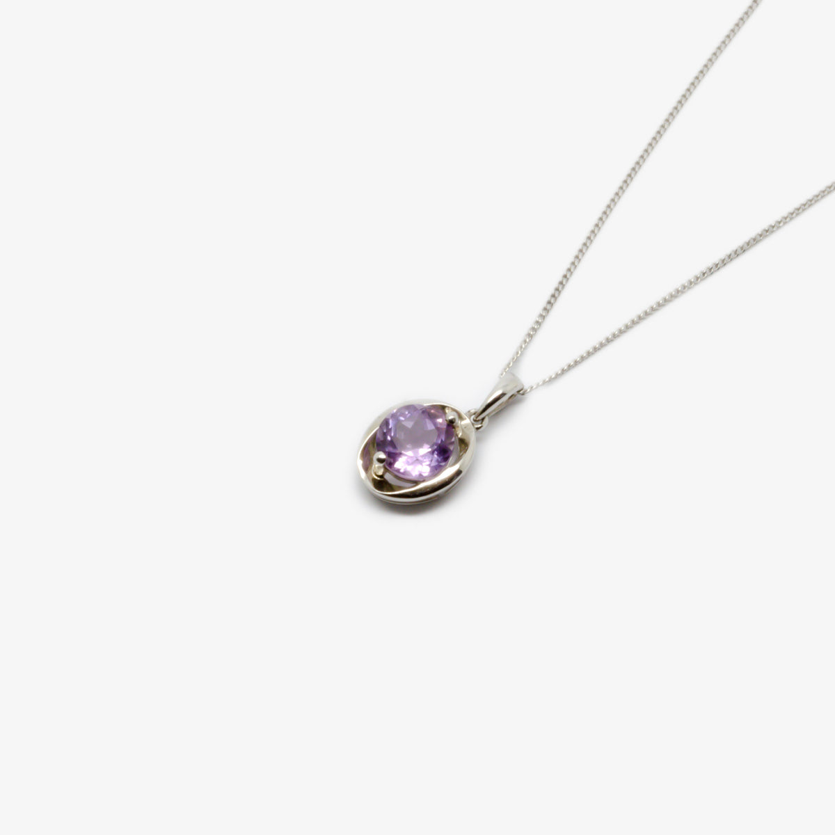 Close-up and from the side picture of the silver amethyst oval pendant necklace.