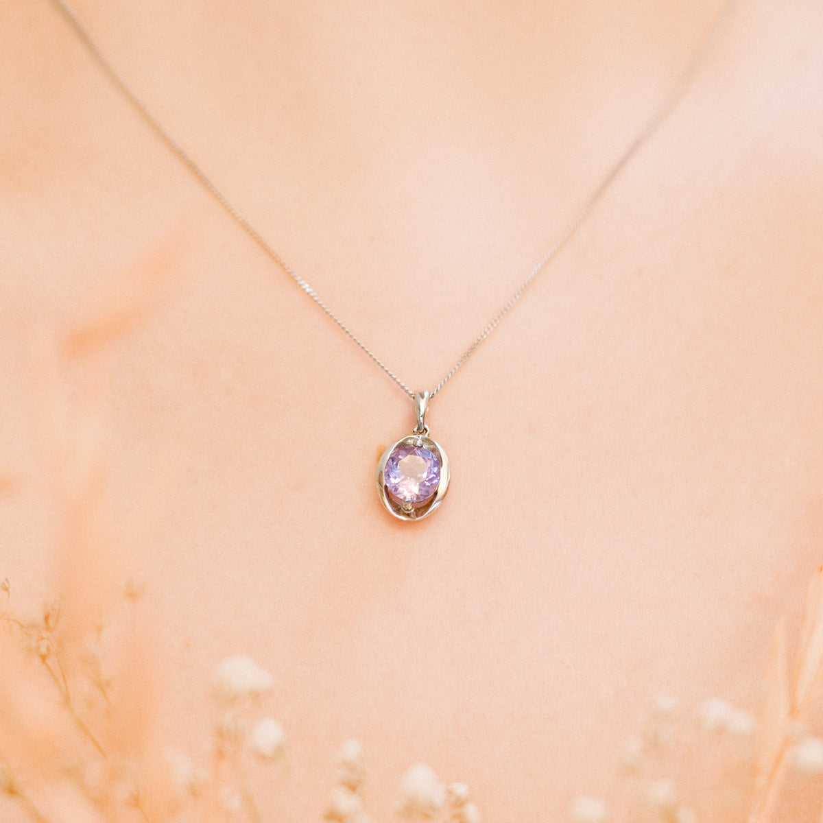 Picture of the oval silver amethyst pendant necklace modelled on a person.