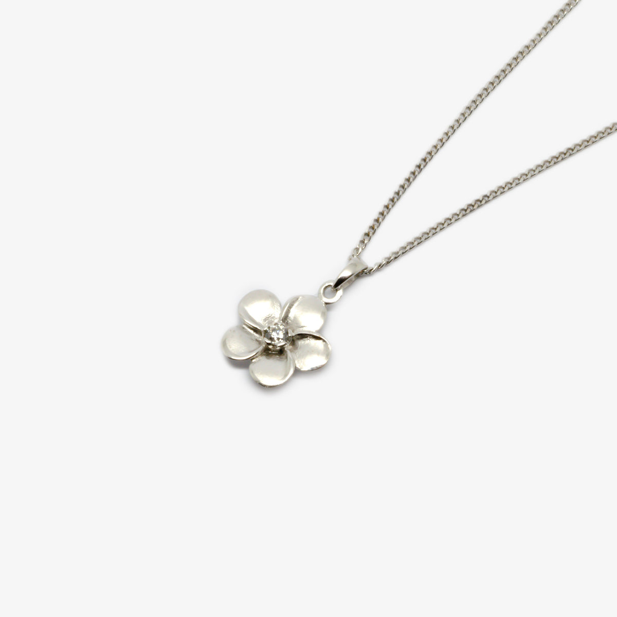 Close-up from the right side of the silver flower pendant necklace.
