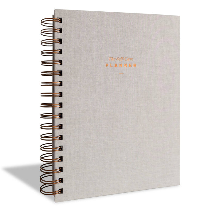 Front of grey linen/spiral bound planner.