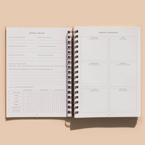 Inside planner: Monthly review page, and monthly intentions page