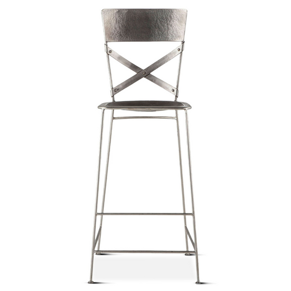 Front view reclaimed iron bar stool with hand hammered texturing in a nickel finish. Contoured seat, cross back with riveted joinery.