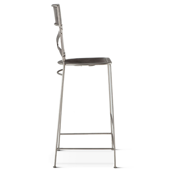 Side view reclaimed iron bar stool with hand hammered texturing in a nickel finish. Contoured seat.