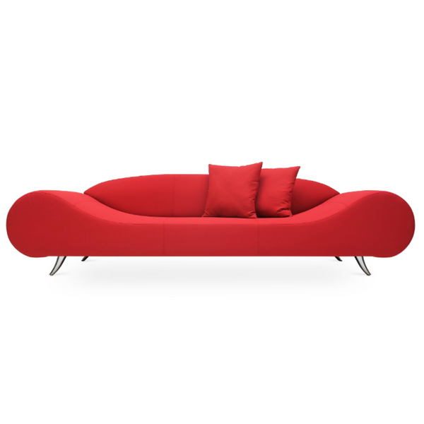 Front view of a modern red sofa that has broad round ends that slope down to a flat seat platform and chrome legs. low contoured integrated back.