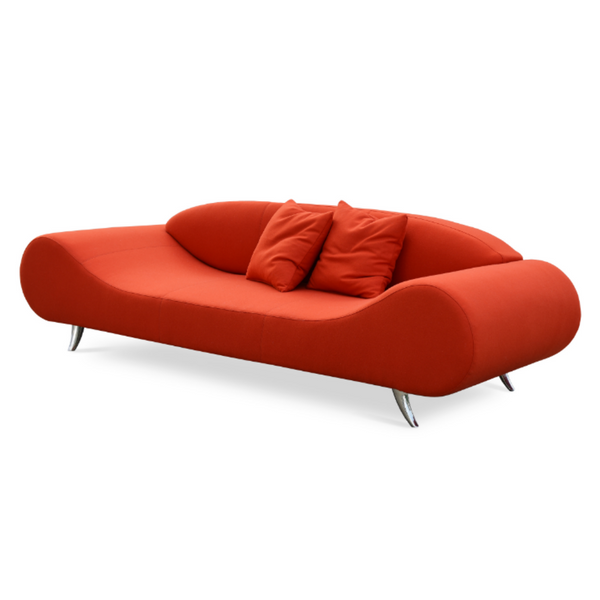 Slightly slanted front view of a modern orange red wool sofa that has broad round ends that slope down to a flat seat platform and chrome legs. low contoured integrated back.