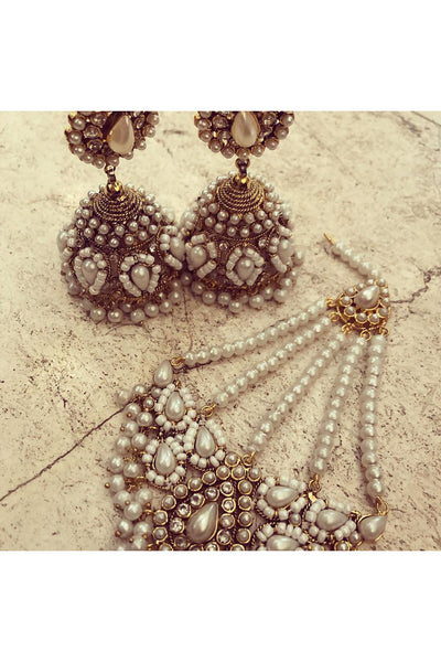 Pearl jhumkis and choker.