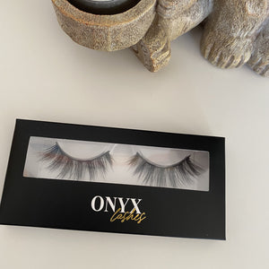 Image of false eyelashes in box on a white background.