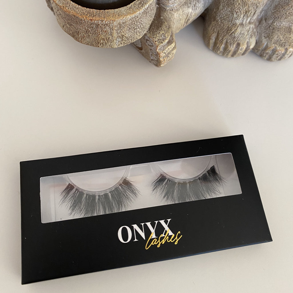 Image shows false eyelashes in black box on a white background.