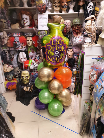 Halloween themed balloon column with poison bottle foil balloon