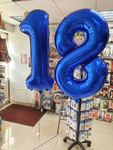 Blue number 1 and 8 foil balloons on weights