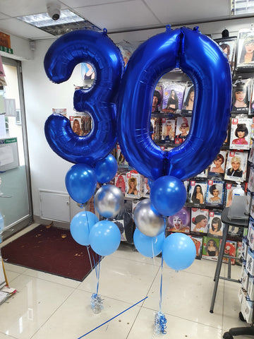 "two five balloon bouquets with 34"" blue number 3 and 0 foil balloons"