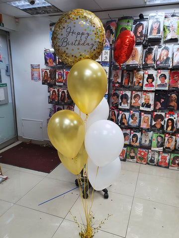 Bunch of 6 helium filled gold and white latex balloons with gold Happy birthday foil balloon and gold weight