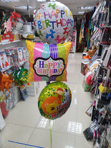 Three happy birthday foil balloons with weight