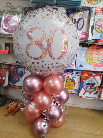 Rose gold & pink air-filled mini centerpiece with 80th birthday foil balloon