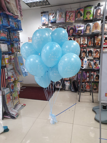 Two bunches of It's a Boy latex balloons on balloon weight
