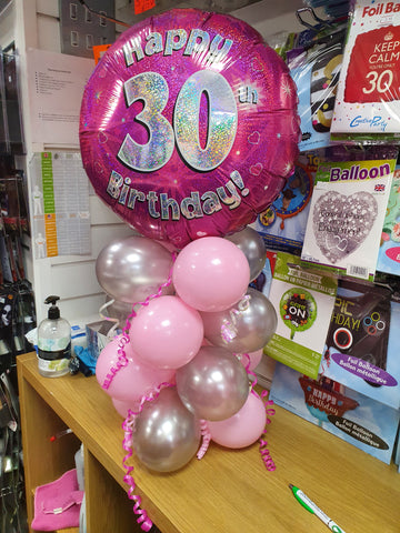 Pink 30th birthday air-filled balloon centrepiece