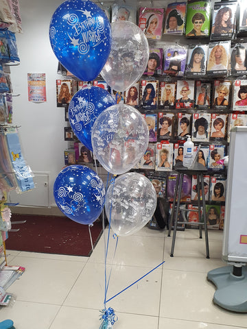 Bunch of six printed blue & clear happy birthday balloons with blue table weight