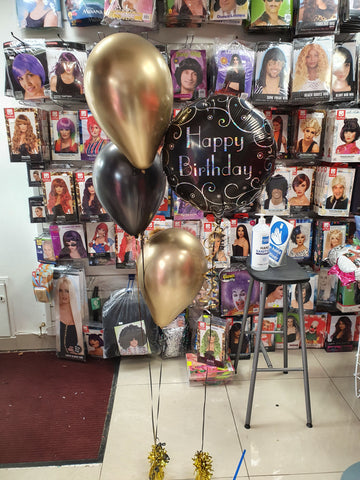 black and gold happy birthday balloon display