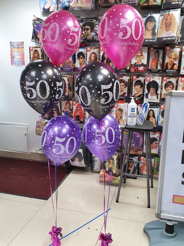 pink black and purple 50th birthday balloon bouquets